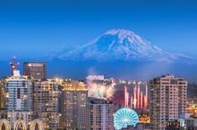 Seattle, Washington, USA Downtown Skyline With Mt. Rainier And A Fireworks Show Below.