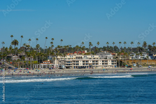 Canvas Print People on the beach enjoying beautiful spring day at Oceanside beach in San Diego, California