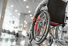 Elderly Lady Is Using A Wheelchair In Airport
