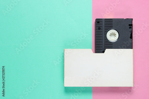 Retro video cassette with cover on color paper background Canvas-taulu