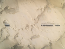 Aerial Abstract View Of Road Covered By Sand In The Desert, Abu Dhabi, UAE.