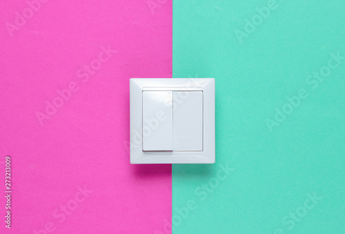 Fotografía  The switch on a colored paper background, minimalism