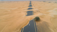 Aerial View Of Highway Covered With Sand In The Desert Of Dubai, United Arab Emirates.