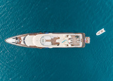 Aerial View Of Luxurious Yacht With Small Tender In The Mediterranean Sea, Mikonos Island, Greece.