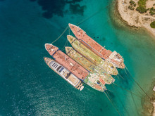 Aerial View Of Old Cargo Boats Anchored In The Mediterranean Sea, Nisi, Greece.