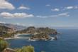 Taormina Sicily panorama of famous Isola Bella, scenic coastline and blue seascape