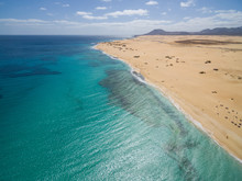Aerial View Of Corralejo?s Big Beaches With Turquoise Sea In Fuerteventura, Canary Islands.
