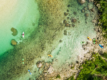 Aerial View Of Kayaks At The Soca River's Shore In Slovenia.