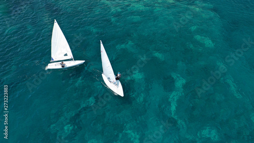 Printed kitchen splashbacks Zanzibar Aerial photo of small sail boat operated by children in exotic tropical bay with turquoise sea