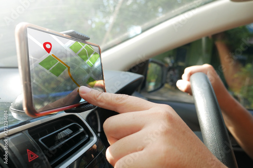 fototapeta na lodówkę GPS Map Navigation on Smart Phone while Driving a Car