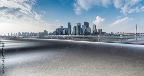 Spoed Foto op Canvas Grijze traf. Panoramic skyline and modern business office buildings with empty road,empty concrete square floor