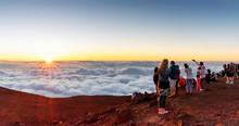 A Crowd Enjoying The Sunset Atop Mount Haleakala On Maui, Hawaii