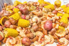 Shrimp Boil Heap: Shrimp Boil Heap With Corn, Baby Potatoes, Mushrooms, Sausage, And Lemons.