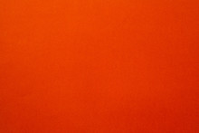 Scarlet Orange Felt Texture Abstract Art Background. Colored Fabric Fibers Surface. Empty Space.