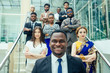 Multi Nationality of business people : indian, korean, afro-american and caucasian stand on the stairs in a modern office with panoramic windows.career enhancement concept