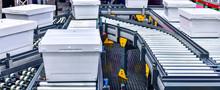 White Plastic Box On Conveyor ...
