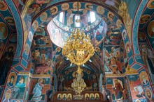Orthodox Church Interior With Golden Chandelier