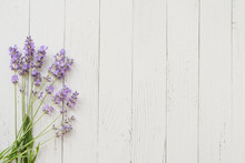Composition Of Lavender On White Wooden Background. Violet Summer Flowers. Free Space