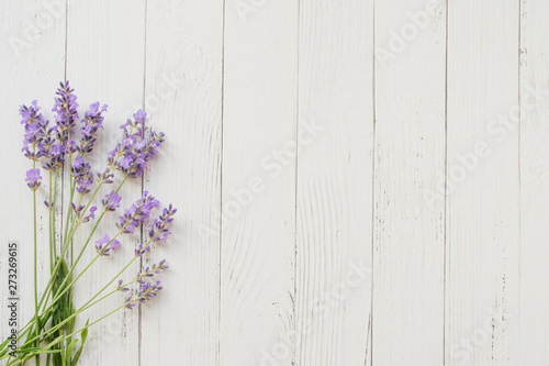 Autocollant pour porte Lavande Composition of lavender on white wooden background. Violet summer flowers. Free space
