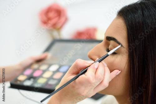 Kiev Makeup artist putting make-up on an woman's eyebrows