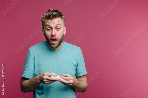 Photo  studio picture from a young man with handkerchief going to sneeze