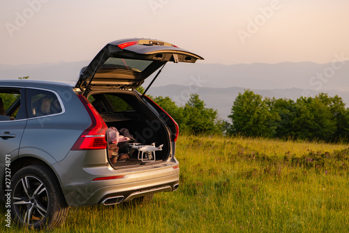 Fototapeta drone ready for fly in suv trunk l