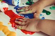 hands of child with paint