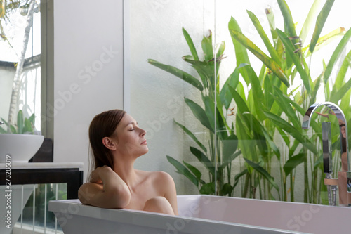 Deurstickers Ontspanning Portrait of a beautiful young woman resting in the bathtub, relaxation and body care concept