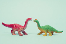 Two Plastic Dinosaurs Facing Each Other