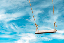 Wooden Swing With Pastel Blue Sky And Cloud Background