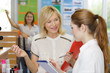 teacher talking to student on beautician course
