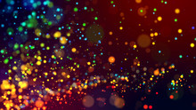 Cloud Of Multicolored Particles In The Air Like Sparkles On A Dark Background With Depth Of Field. Beautiful Bokeh Light Effects With Colored Particles. Background For Holiday Presentations. 140