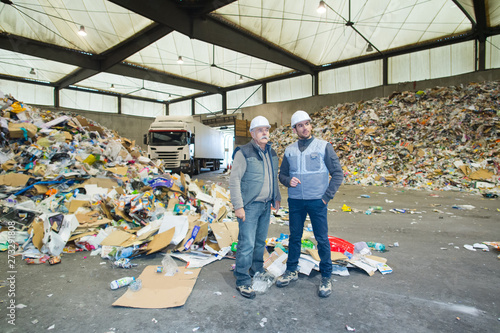 Photo workers at a recycling plant