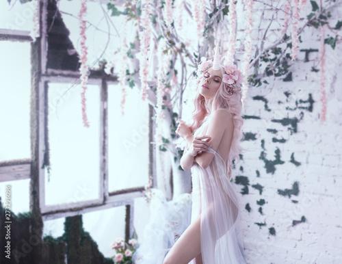 Wonderful creation, the girl is a unicorn in light, white, slightly transparent attire Fototapeta