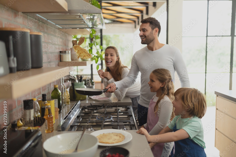 Fototapety, obrazy: Family preparing food in kitchen at home