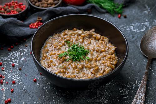 Fototapeta porridge boiled from spelt on bowl obraz