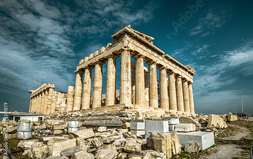 Obraz Parthenon on the Acropolis of Athens, Greece. Ancient Greek Parthenon is a top landmark of Athens. Dramatic view of remains of the antique Athens city. Panorama of the famous temple ruins in summer. - fototapety do salonu