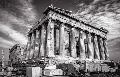 Parthenon in black and white, Athens, Greece. Ancient Greek Parthenon is a top landmark of Athens. Dramatic view of remains of the antique Athens city. Famous temple ruins on the old Acropolis.