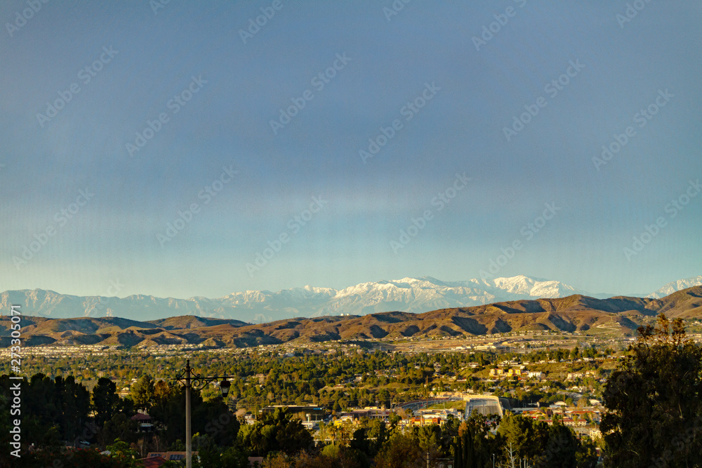 Fototapety, obrazy: Snow capped mountains above the hills of Anaheim California.