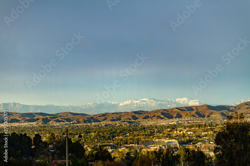 Snow capped mountains above the hills of Anaheim California.