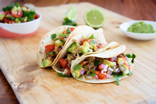 Pulled Pork Tacos With Salsa, Guacamole And Lime In Background, With Copy Space
