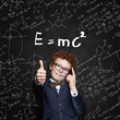Happy school boy on science formulas background