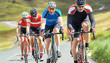 Leinwanddruck Bild - Cyclists out racing along country lanes in the mountains in the United Kingdom.