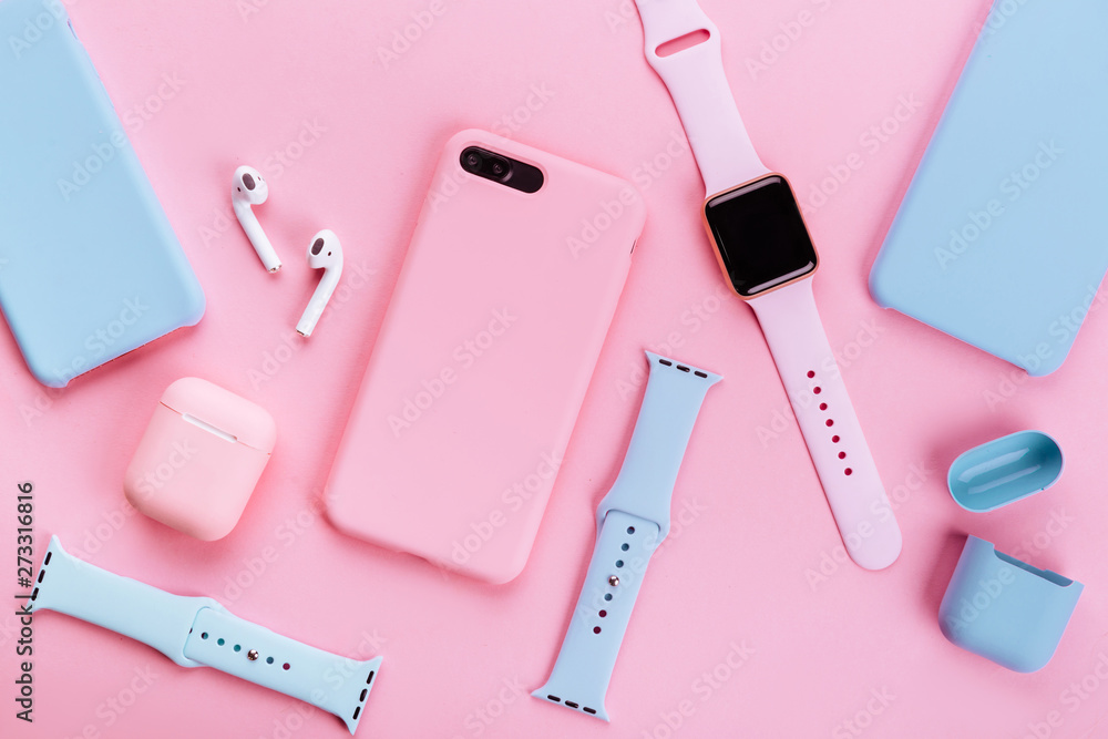 Fototapety, obrazy: Up to date technology.Top view of diverse personal accessory laying on the pink background