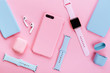 Leinwandbild Motiv Up to date technology.Top view of diverse personal accessory laying on the pink background