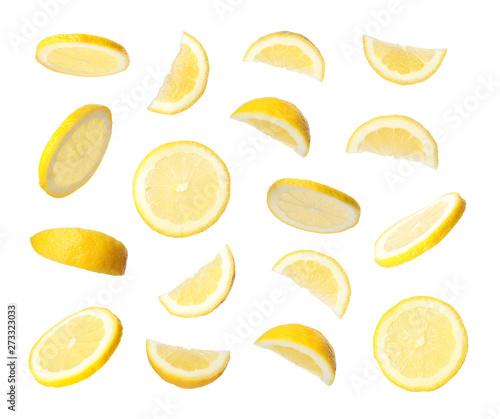 Obraz na płótnie Set of flying cut fresh juicy lemon on white background