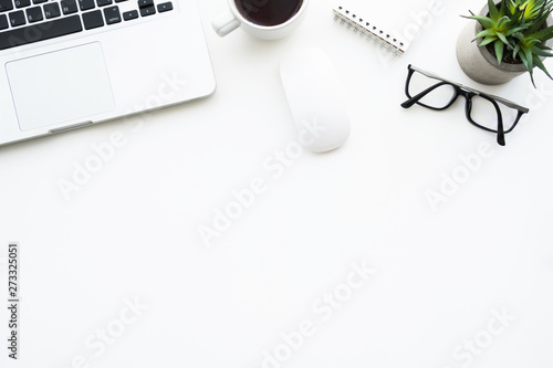 Fotografie, Obraz  White office desk table with laptop computer and lop of supplies on it