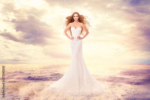 Obraz na plátně Fashion Model in Sea Waves, Beautiful Woman in Elegant White Dress Hairstyle Wav