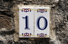 Vintage Number 10.Street Number Plate With Number 10 Closeup On A White Background