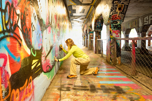 Spray Painting Graffiti in Krog Street Tunnel, Atlanta, Georgia - 273346454